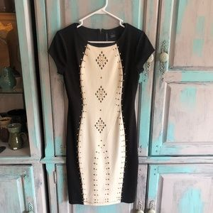 Fitted Black and White dress with gold accents